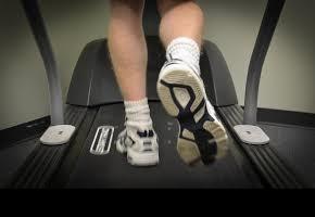 A podiatrist using a treadmill for gait analysis