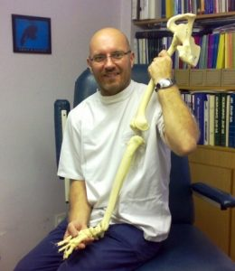 Jonathan Small Family Podiatrist with a model leg skeleton