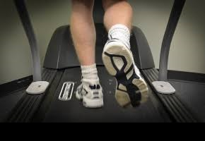 A podiatrist using a treadmill for gait analysis