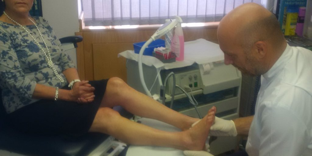 A patient receiving treatment from Jonathan Small at Health First Southam